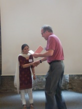 Savita Devi receiving prize from Prof. Richard Lucius in Berlin 2013